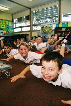 Move to learn, helping children learn better and extend concentration by introducing exercises: children doing the Move to Learn exercises in a classroom