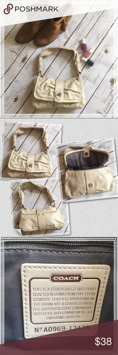"""Coach Cream leather hobo shoulder bag Cream/off-white (not white) authentic Coach hobo shoulder bag. Has a lovely sheen to it on the outside, with a neutral gray interior. Inside has two phone pockets and one zippered side pocket. It has several marks as shown in the last picture, and is priced to sell. If you have the Coach leather cleaner or any other gentle leather cleaner for handbags, the majority of the markings will like clear up. Measures approx. 10"""" x 6.5"""". Coach Bags Hobos"""