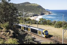 An 'Oscar' runs alongside the Pacific Ocean between Coalcliff and Stanwell Park, heading for Sydney.