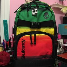 f57f7640135 SKULLCANDY Backpack Color  blackc, red,yellow   green combination. Very  stylish multicolored