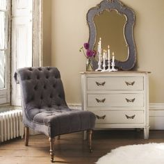 Grey velvet button back chair from Graham and Green UK