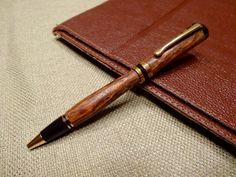 Handmade Bacote wood pen. 24k gold Classic hardware.