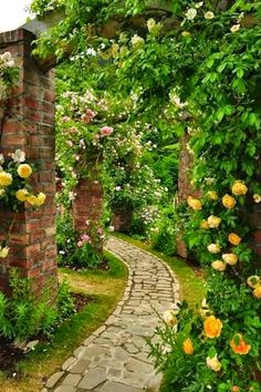 So Relaxing! :) Love the brick columns to grow the climbing roses along the path