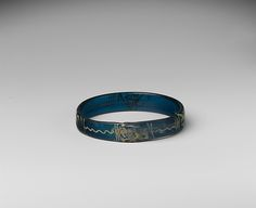 Bracelet with Birds and Geometric Patterns  Date: 1100–1400 Culture: Byzantine Medium: Glass, silver stain Dimensions: Overall: diam. 2 15/16 x 9/16 x 3/16 in. (diam. 7.5 x 1.4 x 0.4 cm)