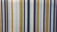 Clean a-symmetrical stripe of olive, navy, icy blue and white.   This is a gorgeous woven fabric sure to make a statement.  Suitable for windows and upholstery applications.