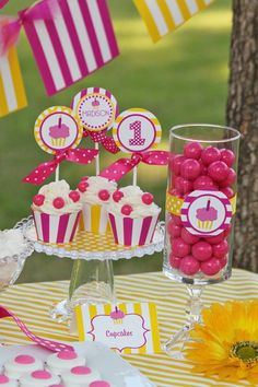 Cupcake Party Table dessert-candy-buffets.  Pink and yellow nice and bright... I want it