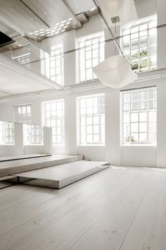 loft interior with large windows, platforms & mirrors