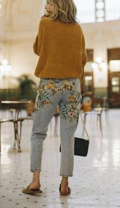 e910e8e9681f82 Pair your favorite embroidered jeans with slip-on shoes and a  mustard-colored sweater