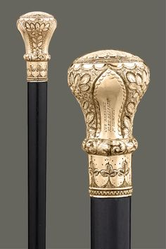 "Exquisite craftsmanship distinguishes this handsome presentation cane. The gold-plated knob is decorated with chasing and repoussé and displays an intricately etched dedication at the crown. Gifted to the notable Pennsylvanian Thomas O'Shell, the cane's inscription reads ""To President Thomas O'Shell / as a mark of high esteem / by Excelsior Lodge, No. 63 / of the A.A. of I. & S.W. / May 10th 1890."" ~ Unique Canes, Incredible Walking Sticks, Decorative Walking Sticks ~ M.S. Rau Antiques"