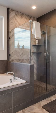 Beautiful bathroom and shower design by Candlelight Homes!