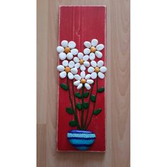 Vase of Daisy's. Painted rock/pebble art.
