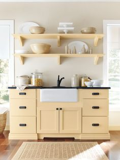 Open shelving and a farmhouse sink create a clean kitchen. #kitchens #organization (Butter Yellow Kitchen)