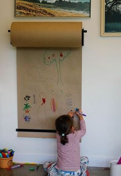 Smart idea for your little artists - wall mounted craft paper for colouring.