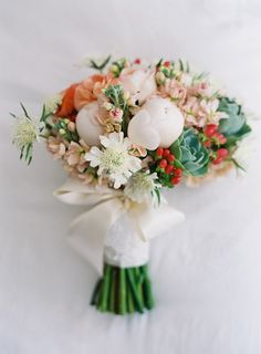pops of berry, coral and blush in this bouquet  #flowers #floral #bouquet #flowers #wedding #bride #bridal #bridalbouquet #bridesmaidbouquet #groomsmen #boutonniere #floraandfauna www.gmichaelsalon