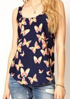 Butterfly tank Visit www.zoeembers.com for boutique clothing without the boutique price tag. Come shop!