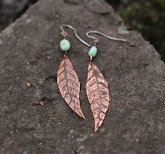 Spring leaves dangling metal work earrings / Copper etched and hammered metalsmith long earrings / Boho hippie rustic handmade jewelry by ViolinDesign on Etsy https://www.etsy.com/listing/221230657/spring-leaves-dangling-metal-work