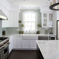 White kitchen cabinets, marble