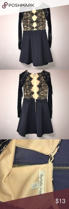 Navy blue cocktail dress from Charlotte Russe Skirt is solid navy blue. Top is nude with navy blue lace. Sleeves are navy blue lace. Back is open from the top of the skirt to the button at the top. Skirt has gold zipper. Worn once, great condition. Size S. From Charlotte Russe. Charlotte Russe Dresses Midi