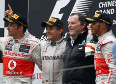 Jenson Button (2nd), Nico Rosberg (1st), Norbert Haug and Lewis Hamilton (3rd). Podium at the Chinese Grand Prix 2012