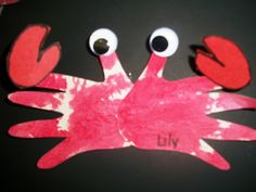 Hand print crab-  Items needed: little hands, red paint, googly eyes, construction paper and glue.  To make: paint child's hand with red paint and make two prints!  Once dry, attach the hand prints at the palms and glue googly eyes to the thumbs.  Finish your crab with pinchers at the top of the pointer finger.  This project was made by our infant program!
