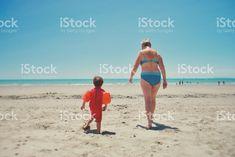 Senior Lady Grandmother walks to Beach with Grandchild royalty-free stock photo Bikini Swimwear, Bikinis, Kiwiana, Bikini Photos, Image Now, Grandchildren, Digital Photography, Walks, Royalty Free Stock Photos