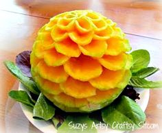carving flower from cantaloupe