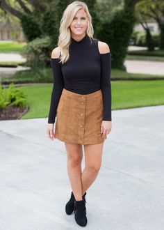 d0fc98b01b This faux suede skater skirt features a snap-buttoned front. Fabric:  Polyester Model: Kaitlin is wears a size and is shown wearing a size small.  RUNS SMALL.
