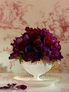 Burgundy anemone arrangement in a teacup