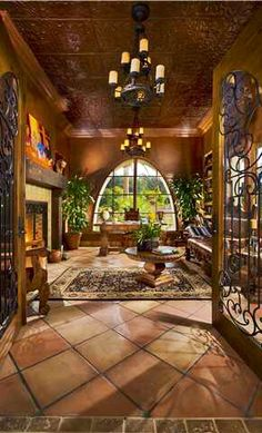 love the doors, and the large terracotta tiles, and the colors, and arched window, and...and...