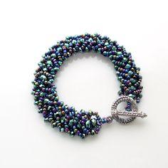 Green crystal bracelet flat spiral bracelet by jinjajewellery, £10.00