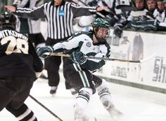 Junior center Lee Reimer dumps the puck into the offensive zone Friday, March 1, 2013, at Munn Ice Arena. Western Michigan defeated the Spartans, 5-2, during the first game of the weekend series. Adam Toolin/The State News