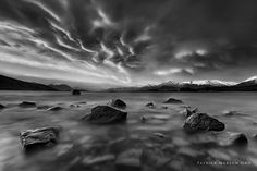 """Earthly Veins - Taken late autumn this year, I seldom do monochrome shots but this one I really felt the urge to convert it. The clouds gave me that creepy feeling like """"bloody veins"""" flowing towards the horizon. I was expecting a cloudy sunset, so just stayed along the shores of Tekapo, took a few shots and didn't expect this would come out. Converted it to black and white in processing, adjusted the curves, dodged and burned to pull out the highlights, shadows and mid-tones, resized and…"""