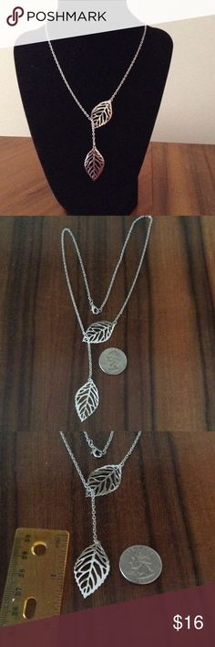 "NWOT 20"" Silver Leaves Necklace Sliding leaf for adjustability allows one of the leaves to move along the chain to give different looks (compare picture 1 to picture 4). Chain measures approximately 20"" long with lobster clasp closure. Leaves measure approximately 1.5"" long x 0.75"" wide. Silver-tone. Jewelry Necklaces"