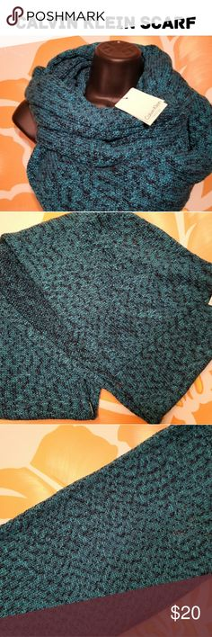 Calvin Klein Infinity Scarf- NWT This teal and black infinity scarf will keep you warm all winter long. This thick scarf can be perfectly paired with your black winter coat or a black vest. Calvin Klein Accessories Scarves & Wraps