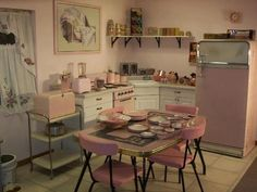 Pink retro kitchen. My late grandma had the exact same Formica dinette set