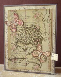 Love the use of the flower as a background stamp and focusing on the butterflies in a soft color.