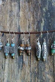 Pewter earrings on silver shepherds hooks.  Glass and Kenyan Giriama beads.