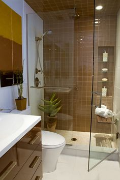 Furniture Bathroom. Cool Furniture Set for Small Bathrooms. Modern Brown White Small Bathroom Design Layout With Cozy Shower Sauna Combo Enclosure With Mounted Wood Seating And Wall Built In Storage Glass Shelves. Bathtub Designs For Small Bathrooms