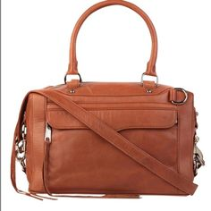 HPRebecca Minkoff Morning After Bag (original) The original Rebecca Minkoff Morning After Bag is a must-have! Genuine leather. Gold hardware. Leather shoulder strap. Ideal for work or play, this iconic satchel is perfect for staying out 'til sunrise. Bag is NWT, but has some marks on the leather (see the pics). The marks do not detract from the overall beauty of this piece!  Dust bag included. (First pic is stock photo.) Rebecca Minkoff Bags Satchels