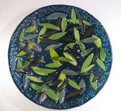 Leaves on pond fused glass platter.