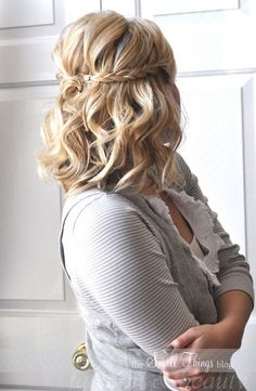 medium hair styles for women - maybe something like this with the braids, but then have the rest pinned up in a chignon or a sideways twist??