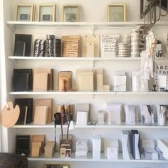 Shop: Sharon Brunsher Ami'ad Street Tel Aviv-Yafo Here you'll find beautiful monochromatic stationery and notebooks mixed in with home accents like brass bowls and simple stemware. Building Kitchen Cabinets, Cabinet Drawers, Shop Plans, Tel Aviv, Display Shelves, Home Accents, Rustic Wood, Bathroom Medicine Cabinet, Layout