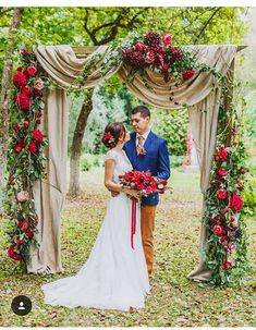 Wedding ceremony arch backdrop with draping and flowers