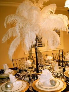 Dessert Buffet for a Great Gatsby Party Have a few feather center pieces on the food table for a Gatsby themed dance! Description from pinterest.com. I searched for this on bing.com/images