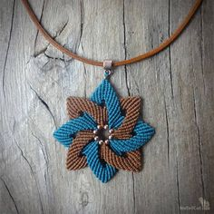 Macrame necklace made with Linhasita 0,75 mm on 2 mm cowhide cord - cornelian color. Colors of thred used: teal and marron You may also like earrings in the same shape: https://www.etsy.com/listing/581426022/macrame-earrings-handcrafted-flower?ref=shop_home_active_1