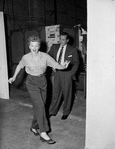 lucille ball two steppin while desi looks on.