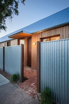 The Carlisle Street extension is a foray into a new-Australian vernacular. Familiar materials and form are used with a higher-consideration to context and passive design, exploring a vernacular for the modern-day. Corrugated Metal Fence, Metal Fence Panels, Gate Design, House Design, Modern Fence Design, Privacy Fence Designs, Backyard Fences, Diy Fence, Fence Ideas
