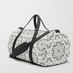 Butterfly Mandala duffle bag.  Design by Hazel Fisher Creations. We upped the Duffle Bag game. Your new favorite gym and travel bags feature crisp printed designs on durable poly poplin canvas. Premium details include soft polyester lining with interior zip pocket, an adjustable shoulder strap (with foam pad), carrying handles, double zipper pull tabs for easy open/close, and brushed nickel metal hardware. Available in three sizes. Spot clean only.
