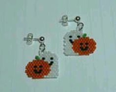 These beaded Ghost and Pumpkin Earrings are done in Peyote Stitch. They are made with glass Delica Beads. They are 1 inches long and Seed Bead Crafts, Beaded Crafts, Seed Bead Jewelry, Seed Bead Earrings, Beaded Jewelry, Seed Beads, Beaded Earrings Patterns, Seed Bead Patterns, Jewelry Patterns