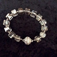 """Foursquare Bracelet Beautiful bracelet, with smokey gray glass cubes fasten with a sparkling magnetic closure... 8"""" NWOT.... Park Lane Jewelry Bracelets"""
